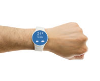 Showing the smartwatch with weather prediction. Hand showing the smartwatch with the weather. All screen content is designed by us and not copyrighted by others Stock Photo