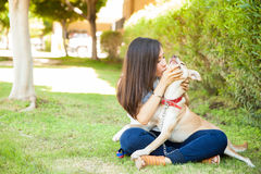 Showing some love to her dog stock photography