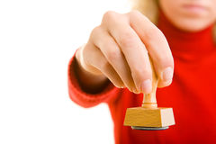 Showing a stamp. Hand holding a rubber stamp stock photos