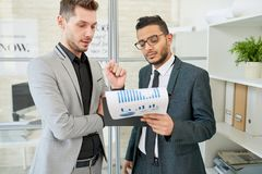 Showing Statistic Data to Colleague royalty free stock photography