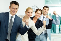 Showing strength. Portrait of business partners showing their strength with leader in front Royalty Free Stock Images