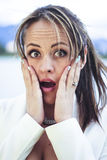 Showing surprise. Young latin woman covering her mouth with a surprised expression Stock Image