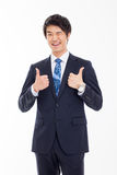 Showing thumb young Asian business man. Royalty Free Stock Photos