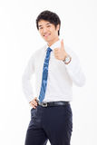 Showing thumb young Asian business man. Royalty Free Stock Photography