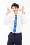 Showing thumb young Asian business man. Royalty Free Stock Image