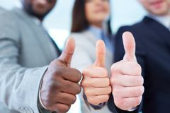 Showing thumbs up Royalty Free Stock Photo