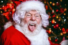 Showing tongue santa stock photo