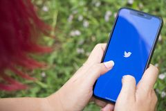 Turkey, Istanbul - September 15.2018: Hands on experience on twitter. Reviewing twitter application. Showing twitter on mobilephon. Showing twitter on royalty free stock photo