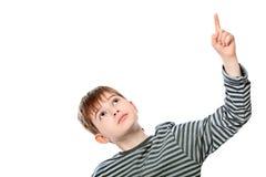 Showing upward. Educational theme: boy teenager showing upward. Isolated over white background Stock Photography