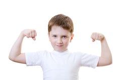 Showinh de garçon sa force photo libre de droits