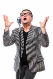 Showman concept. Singer listening music and sing in microphone Stock Image