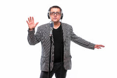 Showman concept. Singer listening music and sing in microphone Stock Images