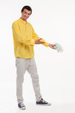 Showman holding pile of cash. Royalty Free Stock Images