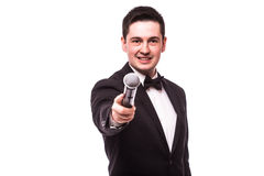 The Showman  interviewer. Young elegant man holding microphone Stock Photos