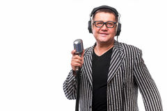 Showman singing in microphone with emotional gesture Stock Image