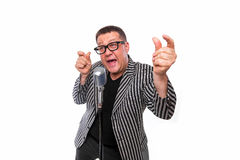 Showman singing in microphone with emotional gesture Royalty Free Stock Images