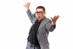 Showman singing in microphone with emotional gesture Stock Photos