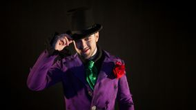 Showman. Young male entertainer, presenter or actor on stage. The guy in the purple camisole and the cylinder. Bright tailcoat, suit Stock Images