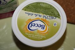 Commercial grocery store news- butter or margarine producers. Shown here is a tub of Becel margarine produced by Upfield, and sold around the world. The topic of royalty free stock photography