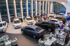Showroom and car of dealership Kia in Kirov city in 2017. Russia, Kirov - October 18, 2017: Showroom and car of dealership Kia in Kirov city in 2017 stock photo