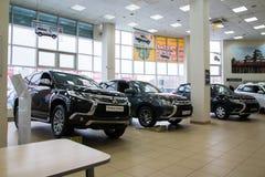 Showroom and car of dealership Mitsubishi in Kirov city in 2016. Russia, Kirov - December 06, 2016: Showroom and car of dealership Mitsubishi in Kirov city in Stock Image