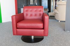 Showroom modern furniture shop with luxury red leather armchair Stock Photos