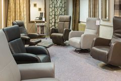 Showroom of modern furniture store with luxury armchairs Royalty Free Stock Photo