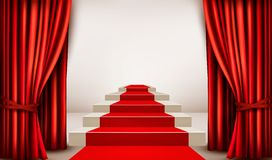 Showroom with red carpet leading to a podium with curtains. Royalty Free Stock Photos