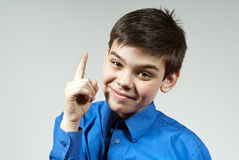 Shows a boy with his finger up. Against the Royalty Free Stock Image