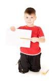 Shows des kleinen Jungen, das zeichnet Stockfoto