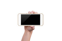 Shows the gold phone in one hand Royalty Free Stock Photos
