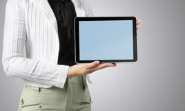 Shows tablet in hand Royalty Free Stock Photo