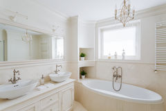 Showy bathroom in cream colors. Horizontal picture of a showy bathroom designed in creamy colors royalty free stock photography