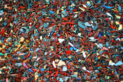 Shreaded Rubber Saturated. These tiny bits of rubber are the cushion for a local playground Stock Photo
