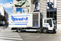 Shred-it truck working on shredding and confidential waste dispo. PARIS, FRANCE - AUGUST 18, 2015: Shred-it truck shredder outside a client's door on Paris Stock Photos