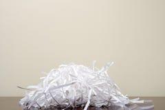 Shredded бумага на столе Стоковые Фото