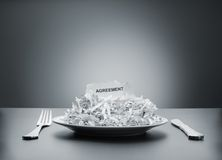 Shredded agreement on the plate Stock Image