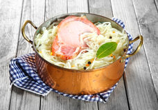 Shredded Cabbage with Smoked Pork Chop on Top Royalty Free Stock Photo