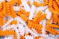 Shredded carrot and radish. Corrugated-shaped shredded carrot and radish Royalty Free Stock Photos