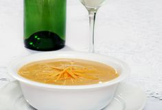 Shredded cheddar cheese soup Stock Image