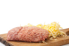 Shredded cheese and minced meat on a kitchen wooden board Stock Photography