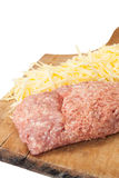 Shredded cheese and minced meat on a kitchen wooden board Royalty Free Stock Photography