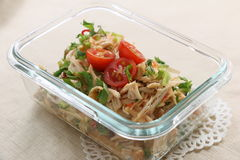 Shredded chicken in glass pot with tomato and herbs Royalty Free Stock Photography