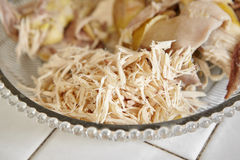 Shredded chicken. For the ingredient for Soto, the traditional Indonesian chicken soup Stock Photos