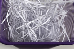 Shredded documents in a wastebasket Royalty Free Stock Photography
