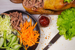 Shredded duck, carrot, cabbage, cucumber, salad, tomato sauce and flat bread Royalty Free Stock Image