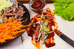 Shredded duck, carrot, cabbage, cucumber, salad, tomato sauce and flat bread Stock Photos
