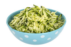 Shredded Grated Raw Zucchini or Courgette Served in Blue Bowl with White Spots Stock Image