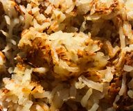 Shredded Hash Brown Potatoes. A perfect breakfast topped off with shredded hash brown potatoes right off the stove stock photography