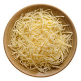 Shredded mild cheddar cheese. On a small ceramic bowl isolated against white background stock image